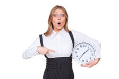 Frau, die auf die Borduhr zeigt Lizenzfreie Stockfotografie