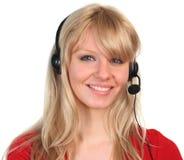 Frau, die auf einem headet spricht lizenzfreie stockfotografie