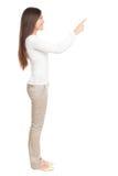 Frau, die auf Exemplarplatz zeigt Lizenzfreie Stockfotografie