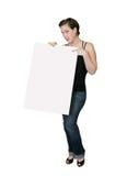 Frau, die auf Zeichen zeigt lizenzfreie stockfotografie