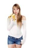 Frau, die Banane hält Stockbilder