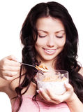 Frau, die Corn-Flakes isst lizenzfreies stockbild