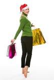 Frau, die das Einkaufen für Weihnachten tut Lizenzfreie Stockfotos