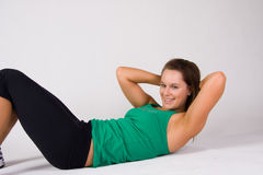 Frau, die das Handeln sitzt, ups   Stockfotografie