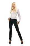 Frau, die in den Jeans aufwirft Lizenzfreie Stockfotos