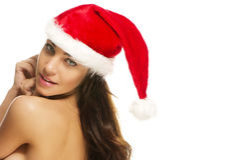 Frau, die den Sankt-Hut schaut über ihrer Schulter trägt Lizenzfreies Stockfoto