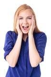 Frau, die in der Verwunderung und im Schock reagiert Stockbild