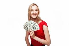 Frau, die Dollarscheine anhält Stockbilder