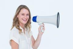 Frau, die durch einen Lautsprecher spricht Stockfotos