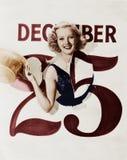 Frau, die durch Kalender am Weihnachtstag birst (alle dargestellten Personen sind nicht längeres lebendes und kein Zustand existi Stockfotografie