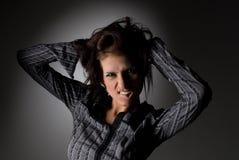 Frau, die ein Gesicht bildet Stockbilder