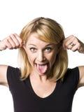 Frau, die ein lustiges Gesicht bildet Lizenzfreies Stockfoto