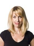 Frau, die ein lustiges Gesicht bildet Lizenzfreie Stockbilder