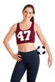 Frau, die eine Fußballkugel anhält Stockbild