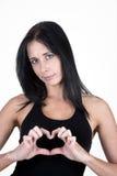 Frau, die eine Innerform mit ihren Fingern bildet Lizenzfreies Stockbild