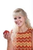 Frau, die einen Apple isst Stockfoto