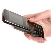 Frau, die einen Handy anhält Lizenzfreies Stockbild