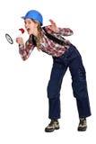 Frau, die in einen Lautsprecher schreit Lizenzfreie Stockfotos
