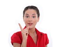 Frau, die einen Punkt macht Lizenzfreie Stockfotografie