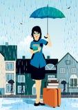 Frau, die einen Regenschirm hält Lizenzfreie Stockfotografie