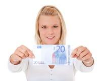 Frau, die Euro 20 hält Lizenzfreie Stockfotos