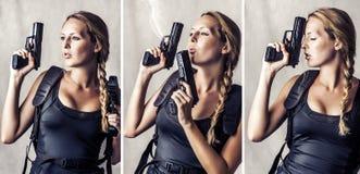 Frau, die Faustfeuerwaffe zwei hält Stockfoto