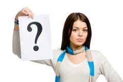 Frau, die Fragezeichen übergibt Stockbilder
