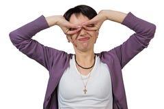 Frau, die Gesichter macht Stockfoto