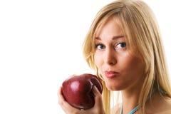 Frau, die gesunden Apfel isst Lizenzfreies Stockfoto