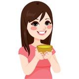 Frau, die grünen Tee trinkt vektor abbildung
