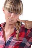 Frau, die ihr Gesicht berührt Lizenzfreies Stockfoto