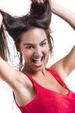 Frau, die ihr Haar ergreift Stockfotografie