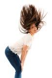 Frau, die ihr Haar leicht schlägt Lizenzfreies Stockbild