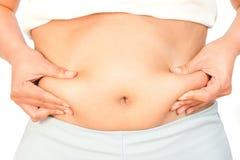 Frau, die ihren Bauch misst Stockfoto