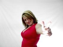 Frau, die ihren Finger zeigt stockbild