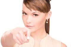 Frau, die ihren Finger zeigt Stockfotografie