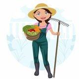 Frau, die im Gemüsegarten arbeitet Stockbilder