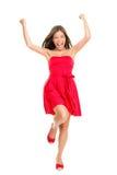 Frau, die im Sommerkleid zujubelt Lizenzfreie Stockfotos