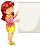 Frau, die leeres Plakat hält Lizenzfreie Stockfotos