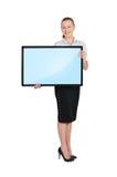 Frau, die leeres Plasma hält Lizenzfreies Stockbild