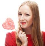 Frau, die lollypop hält Stockfoto