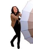 Frau, die mit einem Regenschirm kämpft lizenzfreie stockfotos