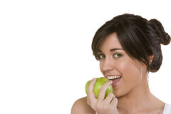 Frau, die Omaapfel isst Lizenzfreie Stockbilder