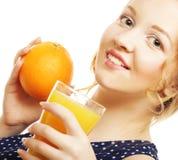 Frau, die Orange hält Stockfotos