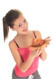 Frau, die Pizza isst Lizenzfreies Stockfoto