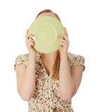 Frau, die Platte leckt Stockfotos