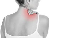 Frau, die Rückenschmerzen hat Stockbilder