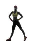 Frau, die stehendes Schattenbild des Eignungstrainings ausübt Lizenzfreie Stockbilder