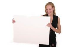 Frau, die unbelegtes Zeichen anhält stockfotos
