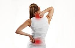 Frau, die unter Rückenschmerzen leidet Stockfotografie